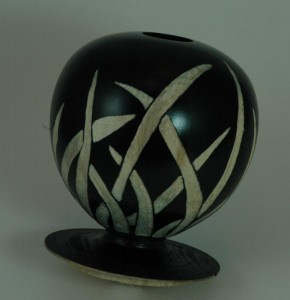 Hollow form from beech, with a grass pattern, still to be coloured